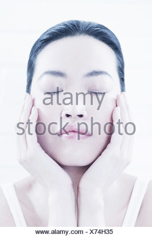 Close up of woman cupping her chin - Stock Photo