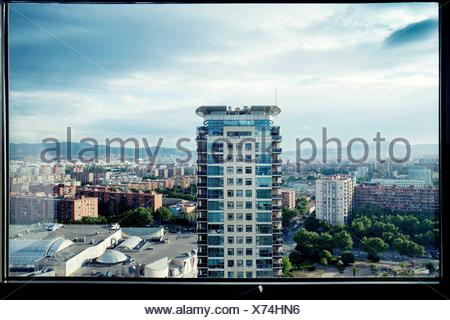 Evening view of residential tower from window. Diagonal Mar, Barcelona, Catalonia, Spain - Stock Photo