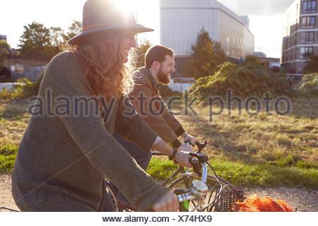 Couple enjoying cycling on marshes - Stock Photo