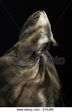 Hooded monk wearing cloak - Stock Photo