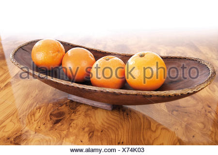 Oranges in a wooden bowl - Stock Photo