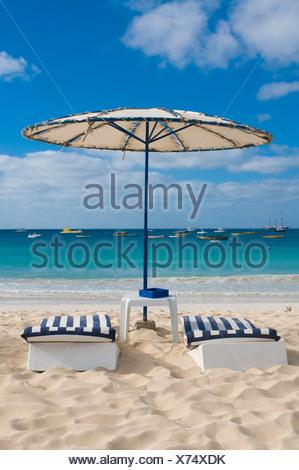 Sun beds and sunshade on the beach, Santa Maria, Sal, Cabo Verde, Cape Verde, Africa - Stock Photo