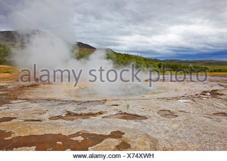 Strokkur Geyser shortly after an eruption, Iceland, Europe - Stock Photo