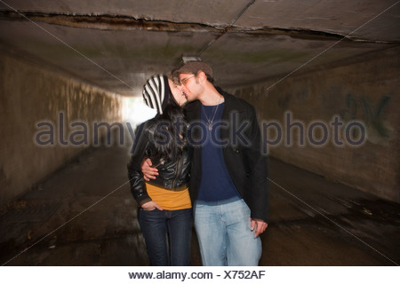 Couple kissing in tunnel - Stock Photo