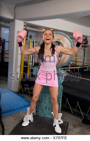 Young woman standing on scales - Stock Photo