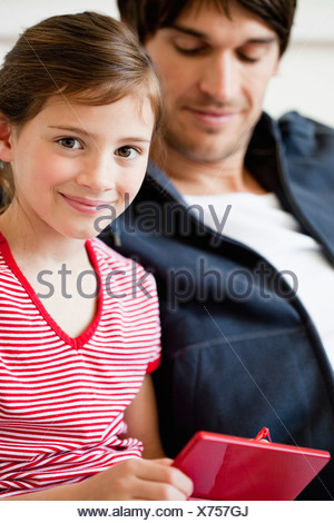 Father and girl playing video game - Stock Photo
