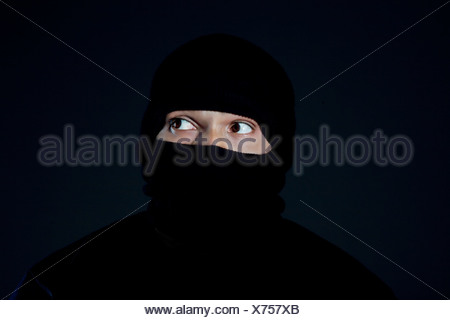 Portrait of a robber - Stock Photo