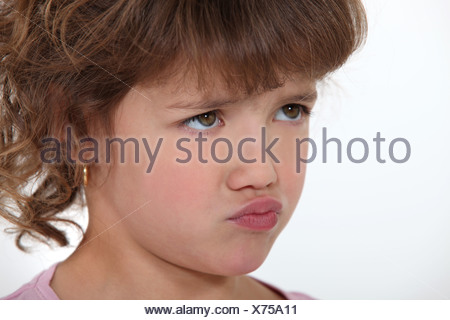Little girl pouting - Stock Photo