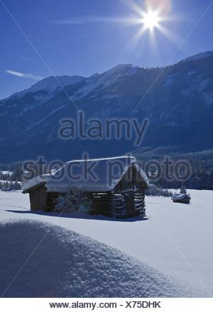 Austria, Europe, Tyrol, Gurgltal, Nassereith, winter, scenery, Stadel, hay barn, mountains, Tschirgant, sky, high, sun, sunrays, - Stock Photo