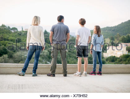 Family standing on terrace - Stock Photo