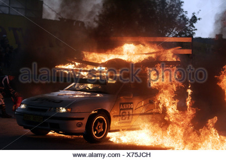 Monstertruck and Stuntshow, a car with a stuntman on the roof is driving through a wall of flames, Radeberg, Saxony, Germany - Stock Photo