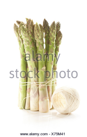 Bunch of green asparagus tied with string - Stock Photo