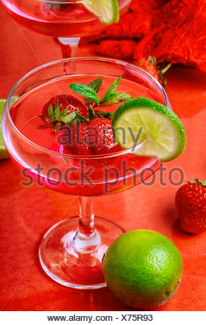 Martini glass with strawberries and red lace - Stock Photo