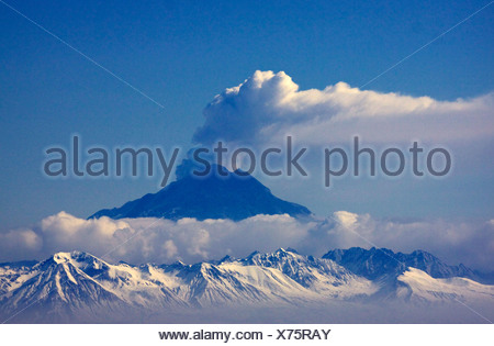 Alaska. Mt Redoubt volcano emitting steam with some ash, as viewed from Kenai. - Stock Photo