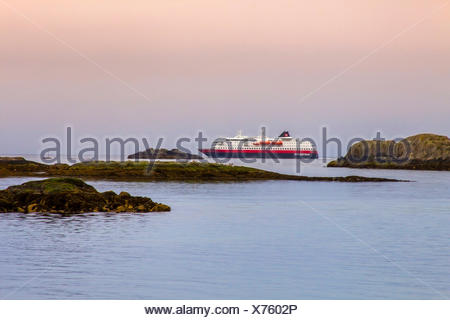 a ship of the Hurtigruten passes the Lofotes, Norway, Lofoten Islands, Svolvaer, Hurtigruten - Stock Photo
