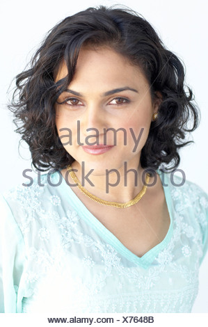 Indian woman smiling - Stock Photo