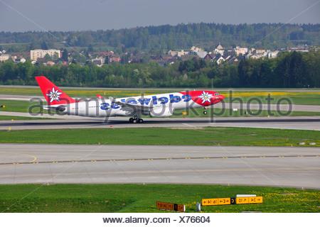 Airplane take-off from Zurich Airport, Switzerland, Europe - Stock Photo