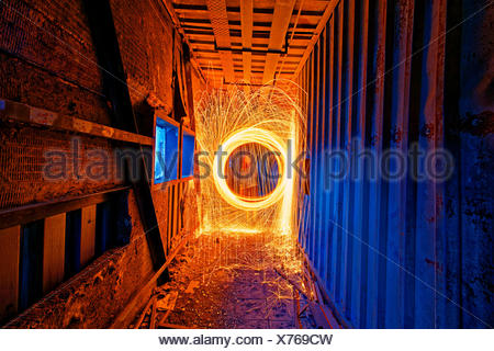 Burning Steel Wool spinning. Showers of glowing sparks from spinning steel wool - Stock Photo