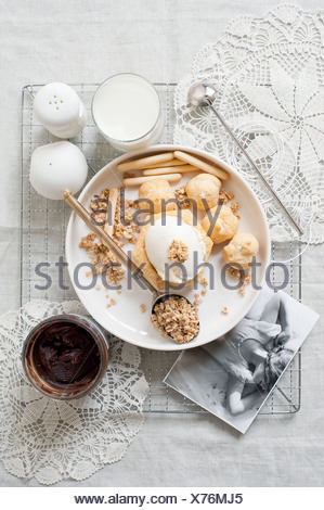 Plate of cream puffs with oatmeal - Stock Photo