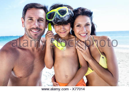 Cute boy wearing snorkeling equipment with his parents - Stock Photo