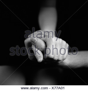 two people holding hands - Stock Photo