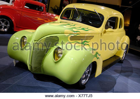 Yellow green Hot Rod Ford Coupe 1938 retro car with flame pattern painted on it, Toronto Auto show 2008 - Stock Photo
