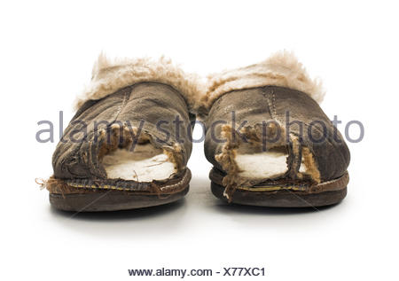 Old torn boots of leather - Stock Photo