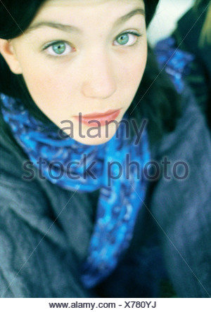Portrait of teenage girl looking at camera, high angle view - Stock Photo
