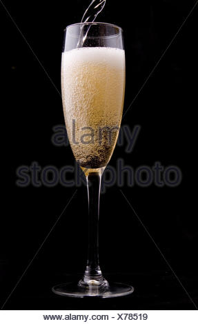 Wine being poured into a glass - Stock Photo