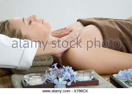 Woman having shoulder massage at spa - Stock Photo