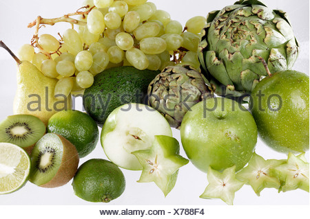Assorted green fruit on white ground - Stock Photo