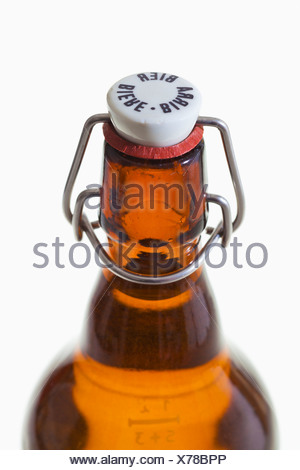 Old beer bottle with hoop lock on white background - Stock Photo