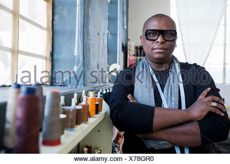 Portrait of man arms with crossed looking at camera - Stock Photo