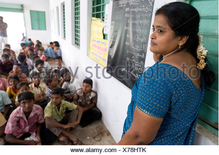 Teacher, children, night school, Sevandhipalayam near Karur, Tamil Nadu, South India, Asia - Stock Photo