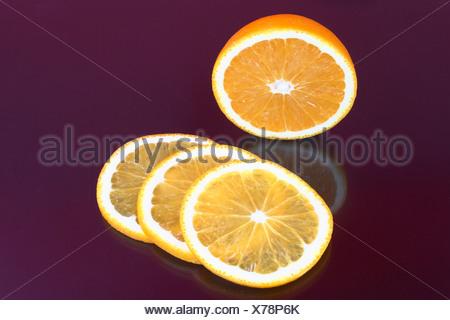 Orange and orange slices - Stock Photo
