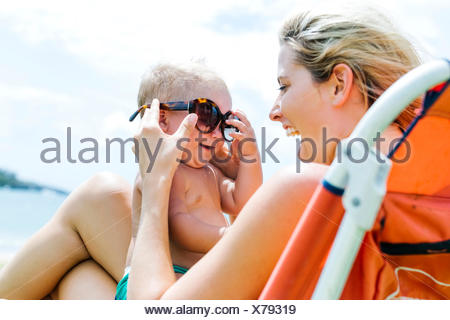 Mother and little son (18-23 months) having fun - Stock Photo