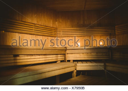 A sauna room with lit candles - Stock Photo