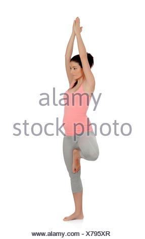 Beautiful pregnant woman doing yoga isolated on white background - Stock Photo