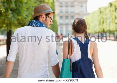Rear view of a couple walking together, Paris, Ile-de-France, France - Stock Photo