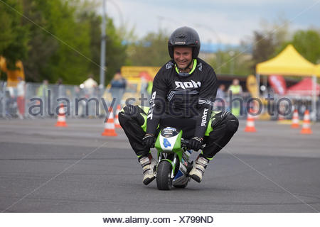 Motorcycle stuntman Mike Auffenberg on a minibike during the ADAC motorbike startup day, Koblenz, Rhineland-Palatinate, Germany - Stock Photo
