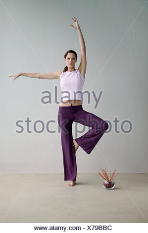 Woman in yoga position - Stock Photo