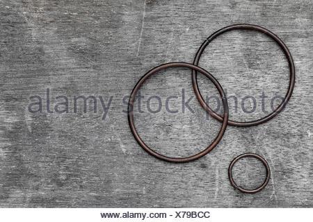 iron ring on old wood, grunge background - Stock Photo