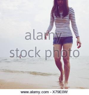 Young Woman Walking On Beach - Stock Photo