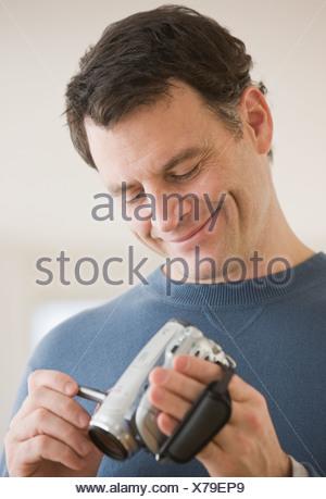 Man looking at video camera - Stock Photo