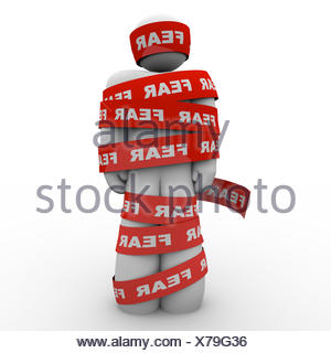 Scared Afraid Man Wrapped in Red Fear Tape - Stock Photo