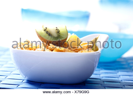 Cornflakes with kiwi and pineapple slices - Stock Photo