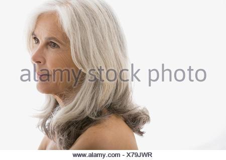Close up of pensive senior woman looking away - Stock Photo