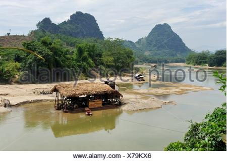 gold digger´s barge on Lo river, Ha Giang province, Northern Vietnam, southeast asia - Stock Photo