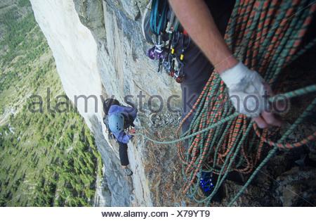 Don't look down while rock climbing, Yamnuska, Alberta, Canda. - Stock Photo