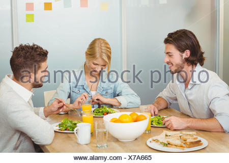 Business people having lunch in office - Stock Photo